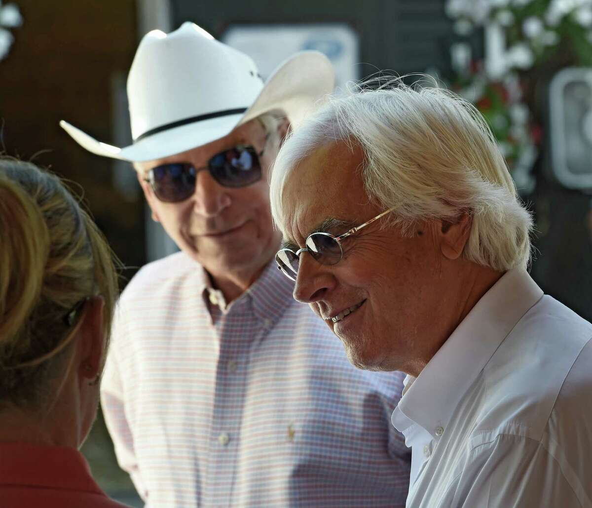 Triple Crown winning trainer Bob Baffert enjoys a laugh with fellow Hall of Fame trainer D. Wayne Lukas Monday Aug. 8, 2016 on the Fasig-Tipton sales grounds in Saratoga Springs, N.Y. The sales commence this evening. The sale will conclude tomorrow evening. (Skip Dickstein/Times Union)