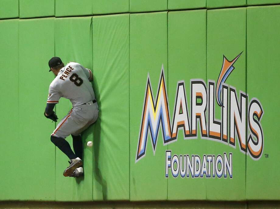Hunter Pence crashes into a wall in a failed attempt to catch a J.R. Realmuto foul ball in the sixth inning. Photo: Wilfredo Lee, Associated Press