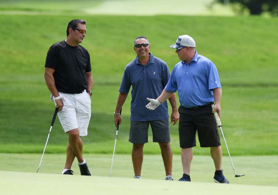 Former New York Mets players Lee Mazzilli, left, John Franco, center, and Point72 Asset Management CEO Steven Cohen chat on the green during the 26th annual Tim Teufel Celebrity Golf Tournament at Tamarack Country Club in Greenwich Monday. The golf outing featured more than a dozen former and current sports celebrities competing on the course to raise money for the Fairfield County Sports Commission. Photo: Tyler Sizemore / Hearst Connecticut Media / Greenwich Time