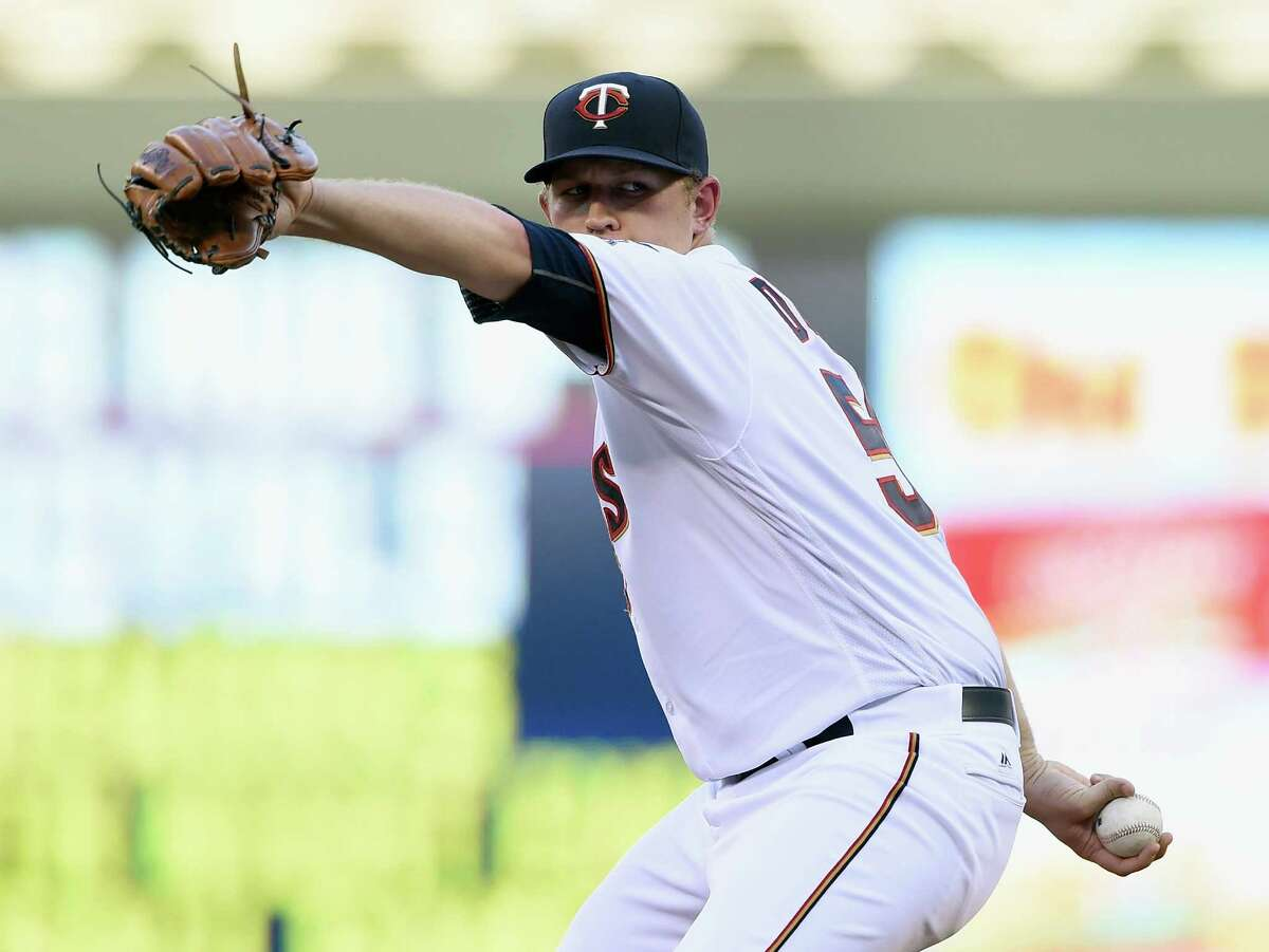 MINNEAPOLIS, MN - AUGUST 08: Tyler Duffey #56 of the Minnesota Twins delivers a pitch against the Houston Astros during the second inning of the game on August 8, 2016 at Target Field in Minneapolis, Minnesota.
