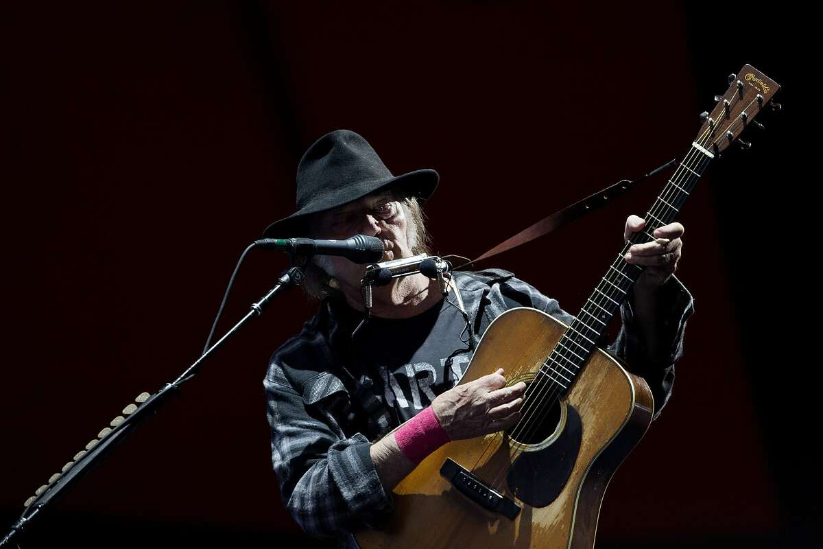 Canadian singer and composer Neil Young performing at the Roskilde Festival in Roskilde, Denmark, Friday evening, July 1, 2016.