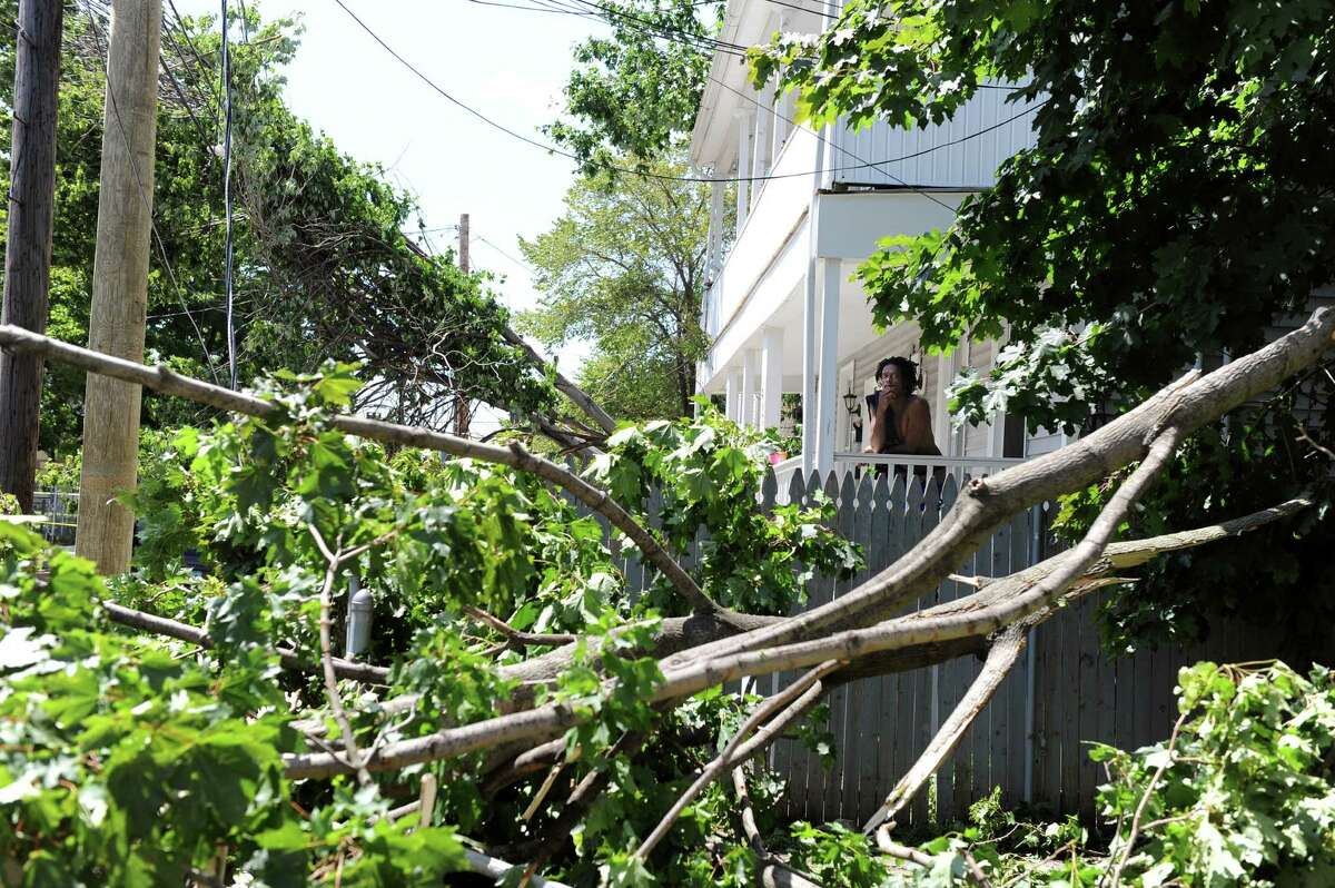 A man surveys the damage on Kossuth Street in Bridgeport Friday June 25, 2010. The damage was the result of a tornado with 100 mph winds that touched down in Bridgeport Thursday.