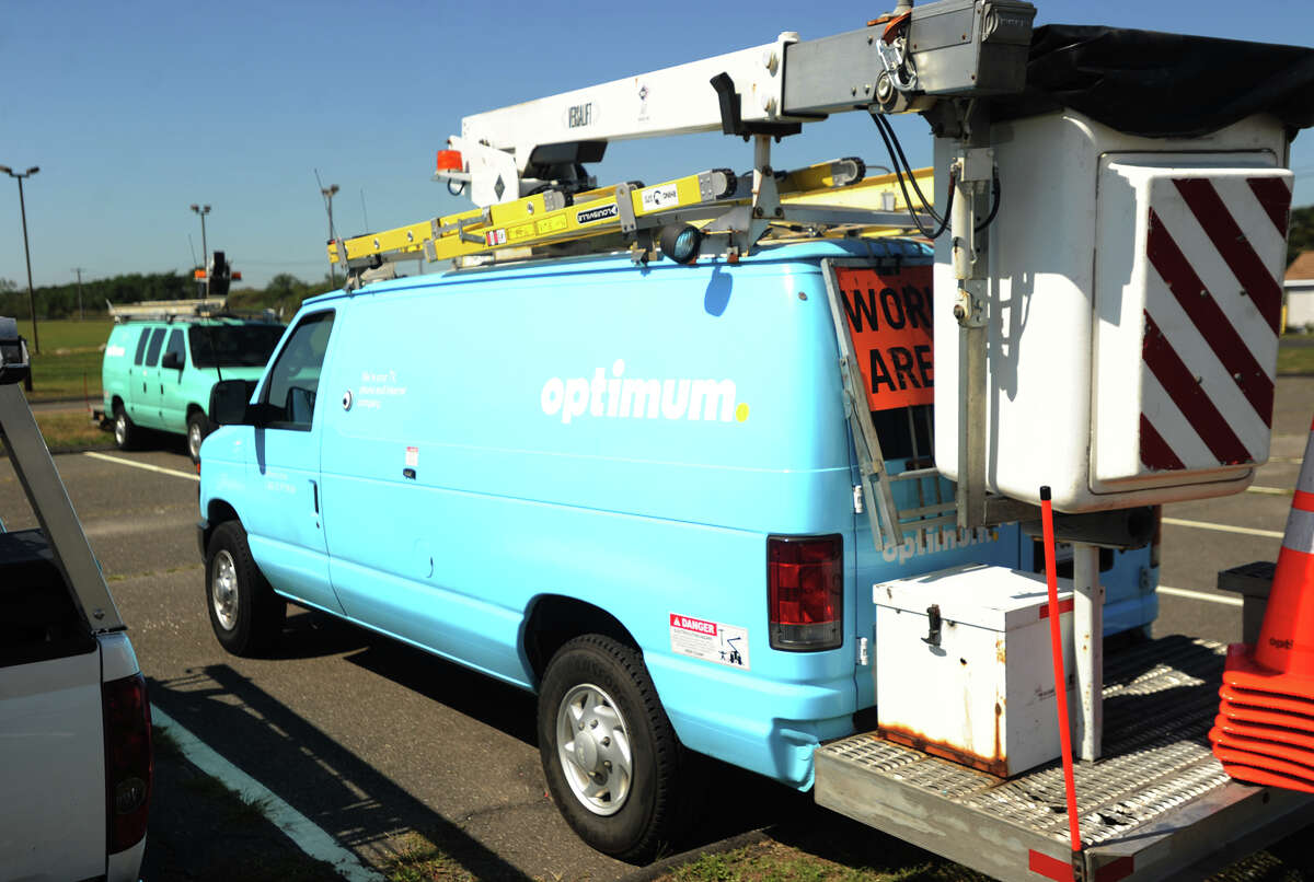 Cablevision vans are parked at Short Beach Park in Stratford, Conn. at an employee barbecue in September 2015.