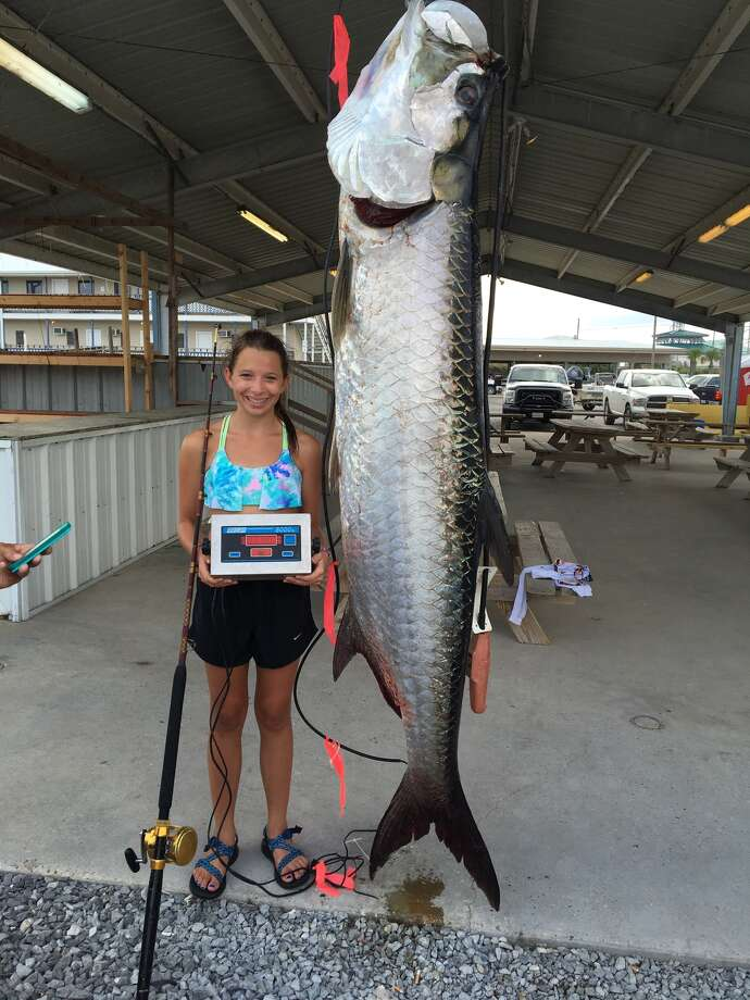 Ivy Robichaux, 14, with the 188-pound tarpon she caught off the coast of Louisiana that is now pending confirmation to be an International Game Fish Association record-breaker for her age group. Photo: Provided By Simone Robichaux