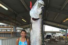 Ivy Robichaux, 14, with the 188-pound tarpon she caught off the coast of Louisiana that is now pending confirmation to be an International Game Fish Association record-breaker for her age group.