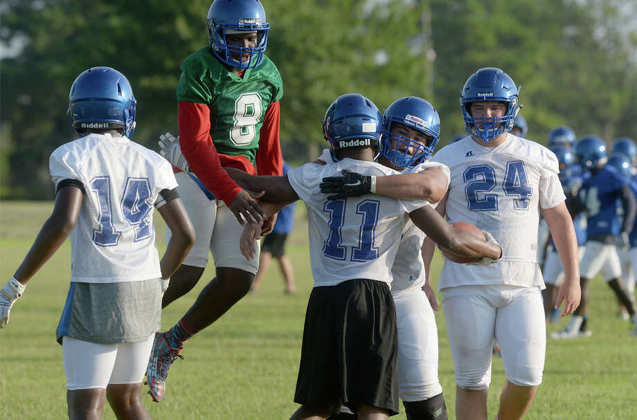 West Brook celebrate a long run during practice on the Bruin's practice field Monday. Photo taken Monday, August 08, 2016 Guiseppe Barranco/The Enterprise Photo: Guiseppe Barranco, Photo Editor