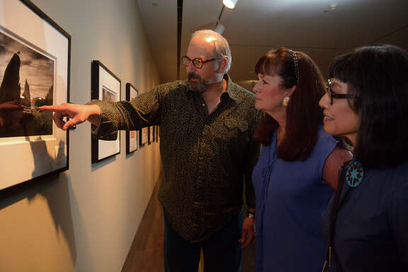 Photographer Mark Burns, left, talks about his 2015 photo of Olympic National Park in Washington with Pearl Fincher Museum of Fine Arts curator Terry Capps and Lone Star College-Kingwood Professor of Art Mari Omori.Photographer Mark Burns, left, talks about his 2015 photo of Olympic National Park in Washington with Pearl Fincher Museum of Fine Arts curator Terry Capps and Lone Star College-Kingwood Professor of Art Mari Omori.