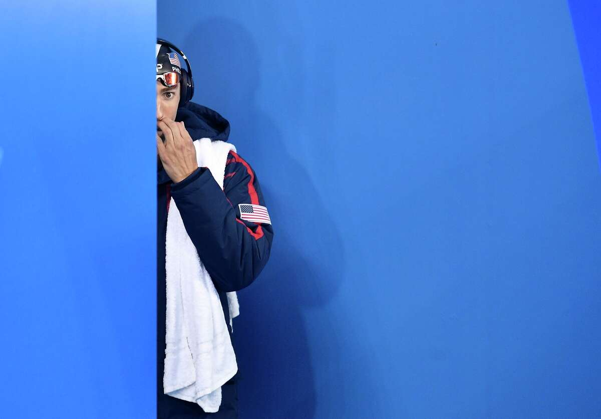 United States' Michael Phelps arrives for a men's 200-meter butterfly semifinal during the swimming competitions at the 2016 Summer Olympics, Monday, Aug. 8, 2016, in Rio de Janeiro, Brazil. (AP Photo/Martin Meissner)