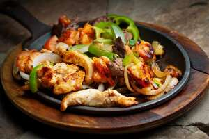 """1985: FAJITAS   The origins of this dish perhaps go back to the American southwest in the 1930s, when cowboys cooked beef over campfire. It gained traction through the '60s and '70s as Tex-Mex cuisine spread across the U.S. In the '80s, a German-born chef named George Weidmann put """"sizzling fajitas"""" on the menu at the Hyatt Regency in Austin, and according to the  Austin Chronicle , """"sales of that signature dish made it the most profitable restaurant in the Hyatt chain."""""""