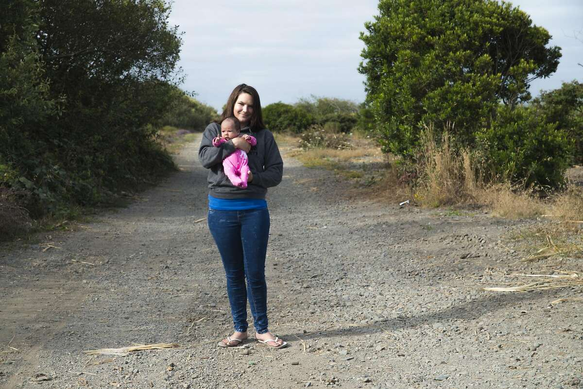 """On August 8, Sarah Hood takes newborn, Komorebi Kangas, to Palco Marsh where she stayed when she was pregnant. Her little girl's name is Japanese for, """"the sunlight that filters through the leaves of the trees."""""""