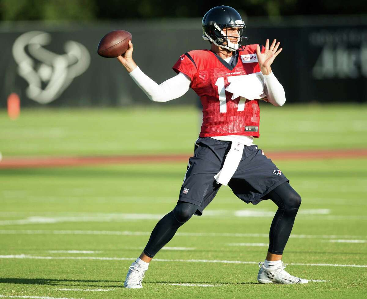 Houston Texans quarterback Brock Osweiler throws a pass as he warms up during Texans training camp at Houston Methodist Training Center on Tuesday, Aug. 9, 2016, in Houston.