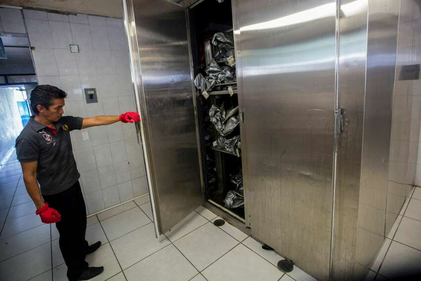 A forensic staffer shows the morgue's cold chambers full of body bags in Acapulco, Mexico on July 13, 2016. With a population of 810,000 the touristic resort of Acapulco ranks as one of the most violent cities in the world, with a crime rate of 111 murders per 100,000 inhabitants in 2015.
