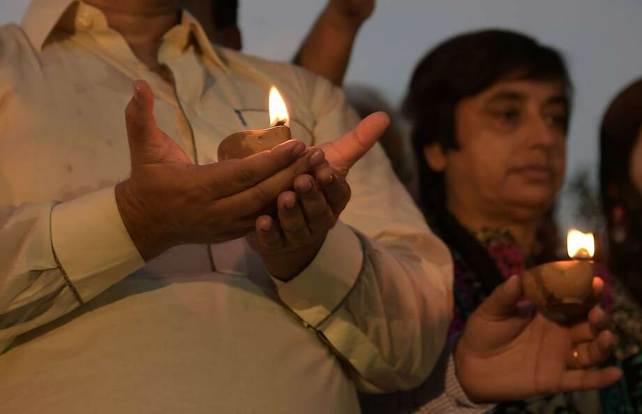 Pakistani journalists hold oil lamps at a vigil for colleagues and lawyers who were killed in a suicide bombing in Quetta. Photo: AAMIR QURESHI, AFP/Getty Images
