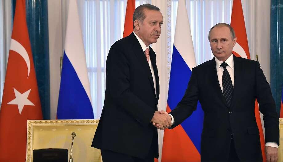 Turkish President Recep Tayyip Erdogan (left) meets with Russian counterpart Vladimir Putin. Photo: ALEXANDER NEMENOV, AFP/Getty Images