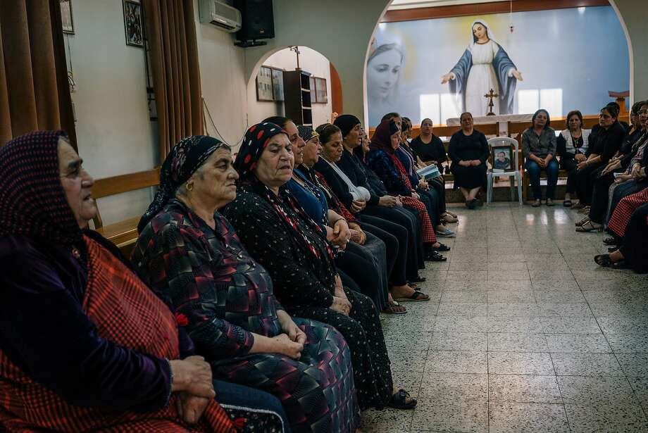 Christian women gather at a memorial service at an Assyrian church in Irbil, Iraq. Religious minorities say liberating the area from the Islamic State group won't ensure their safety. Photo: Alice Martins, Associated Press