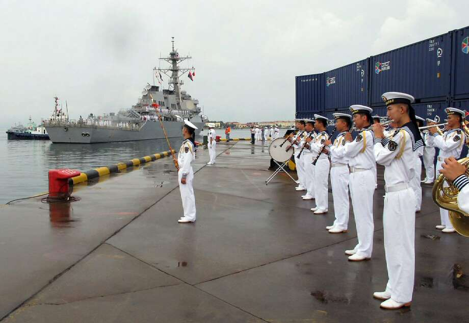 A Chinese military band welcomes the U.S. guided missile destroyer Benfold to Qingdao on Monday. Photo: Borg Wong, Associated Press