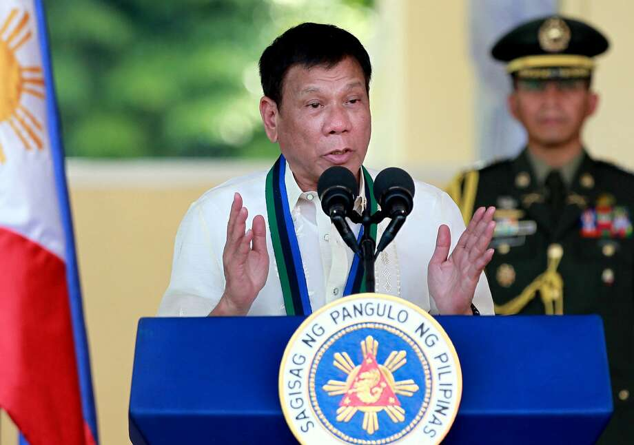 FILE - In this Friday, July 1, 2016, file photo, Philippine President Rodrigo Duterte addresses the troops during a military ceremony in suburban Quezon city, northeast of Manila, Philippines. The U.S. government expressed Monday, Aug. 8, concern over extrajudicial killings of suspected drug dealers and users in a bloody crackdown overseen by Duterte and urged his government to ensure law enforcement efforts comply with human rights obligations. (AP Photo/Bullit Marquez, File) Photo: Bullit Marquez, Associated Press
