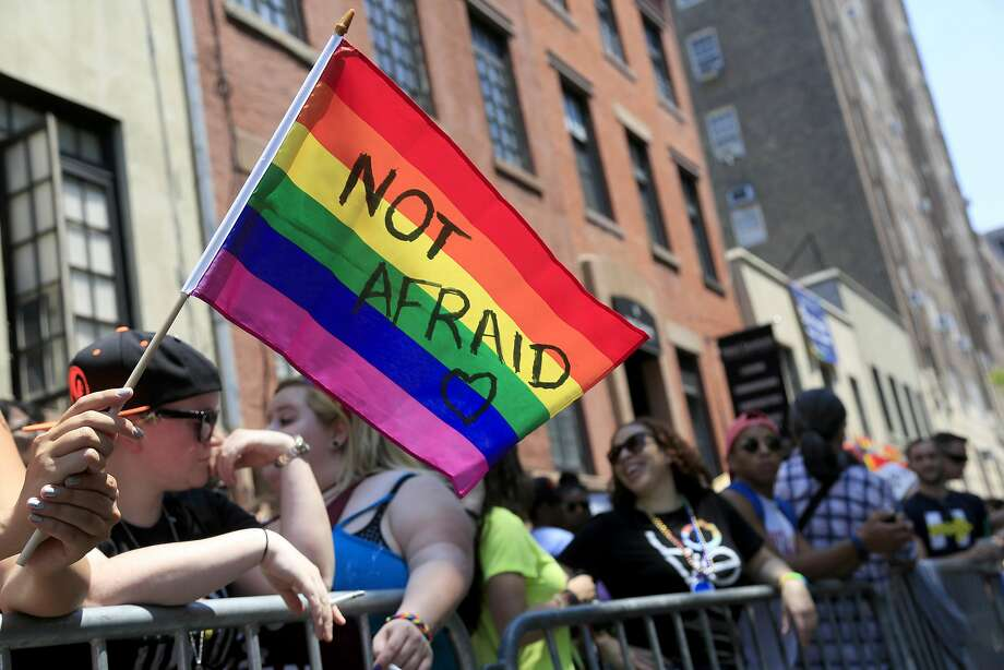 Participants back gay rights during New York's Pride Parade in June. Young Amer icans overwhelmingly support LGBT rights when it comes to employment, health care and adoption. Photo: Seth Wenig, Associated Press