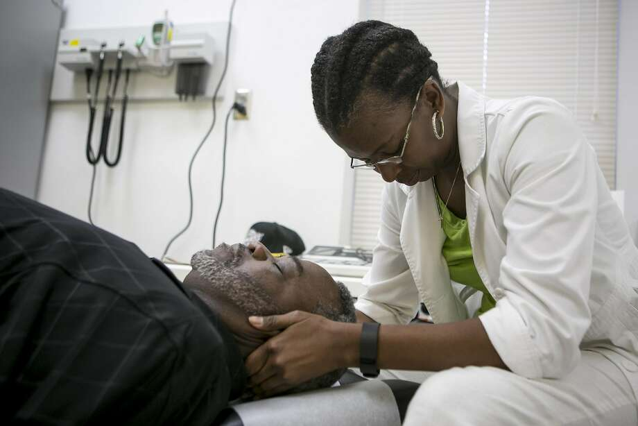 Toya Burton, a chiropractor at Whatley Health Services Inc., treats Robert Prince in Tuscaloosa, Ala. African Americans tend to receive less treatment for pain than whites. Photo: ILANA PANICH LINSMAN, NYT
