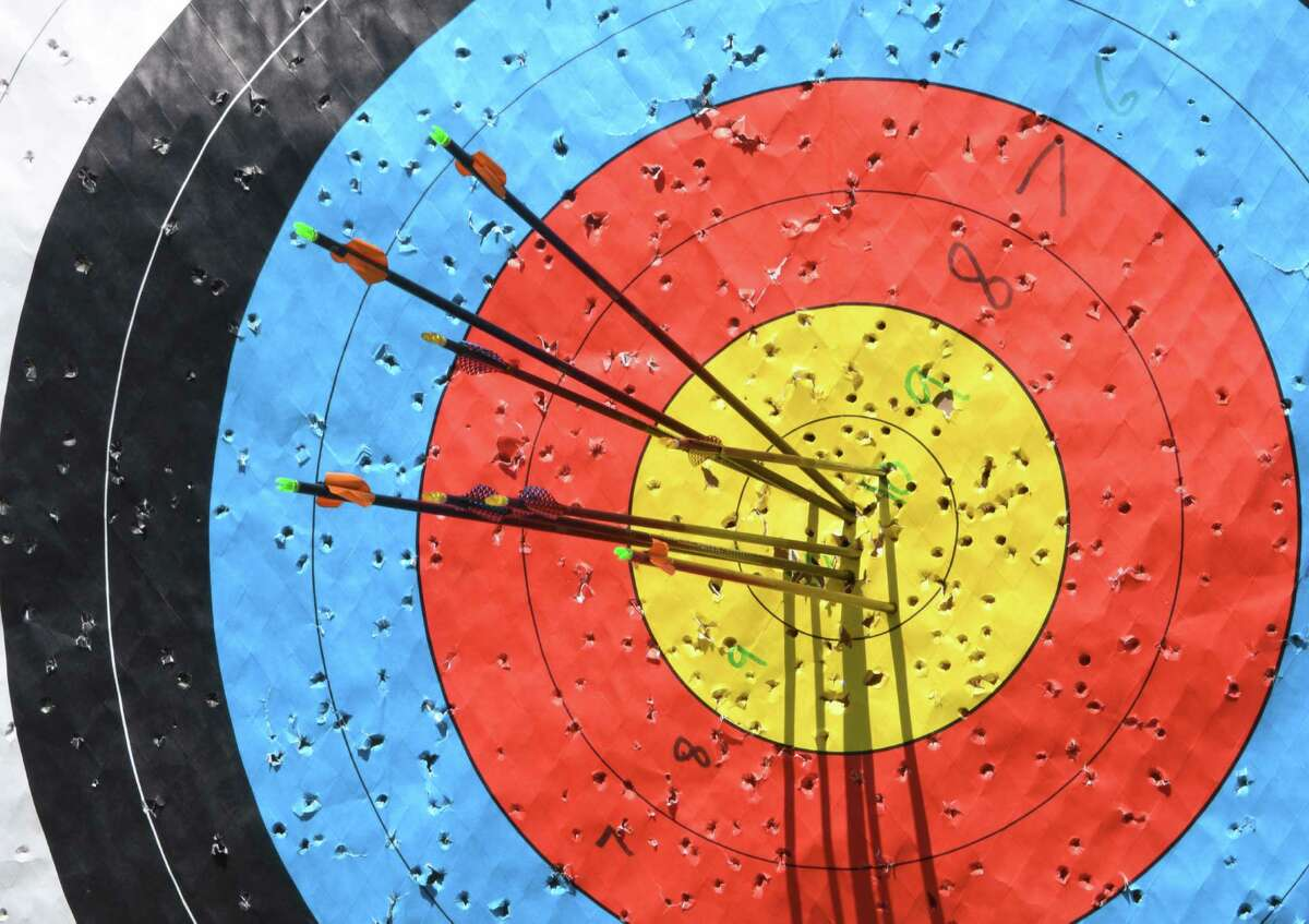 Arrows are seen in the bullseye of a target at the Heldeberg Workshop where people can learn archery on Sunday, Aug. 7, 2016 in Altamont, N.Y. This is just one place where people can try some Olympic sports locally. (Lori Van Buren / Times Union)