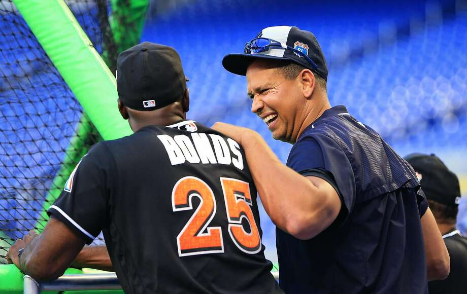 New York Yankees designated hitter Alex Rodriguez, right, talks with Miami Marlins hitting coach Barry Bonds before an exhibition baseball game on Friday, April 1, 2016, in Miami, Fla. (AP Photo/Rob Foldy) Photo: Rob Foldy, AP