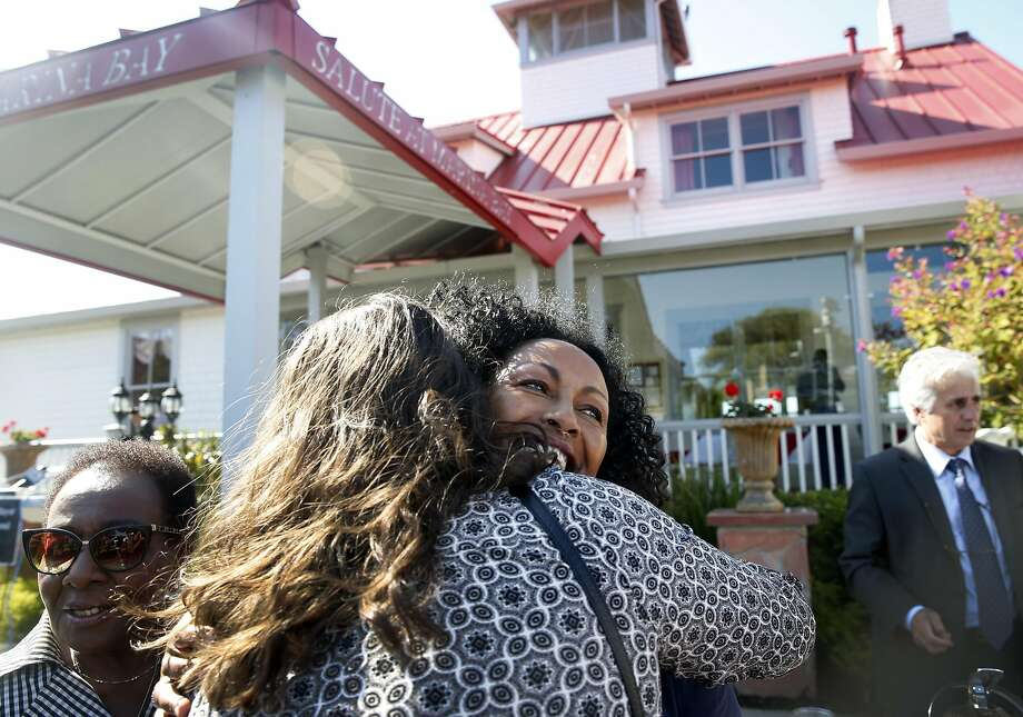Restaurateur Menbere Aklilu (center) hugs one of the many supporters attending a rally at her Salute e Vita restaurant in Richmond, Calif. on Tuesday, Aug. 9, 2016. The popular restaurant and its philanthropic owner Menbere Aklilu have been issued a 30-day eviction notice by the property's landowner, which is sparking outrage throughout the community. Photo: Paul Chinn, The Chronicle