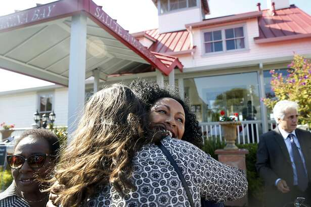 Restaurateur Menbere Aklilu (center) hugs one of the many supporters attending a rally at her Salute e Vita restaurant in Richmond, Calif. on Tuesday, Aug. 9, 2016. The popular restaurant and its philanthropic owner Menbere Aklilu have been issued a 30-day eviction notice by the property's landowner, which is sparking outrage throughout the community.