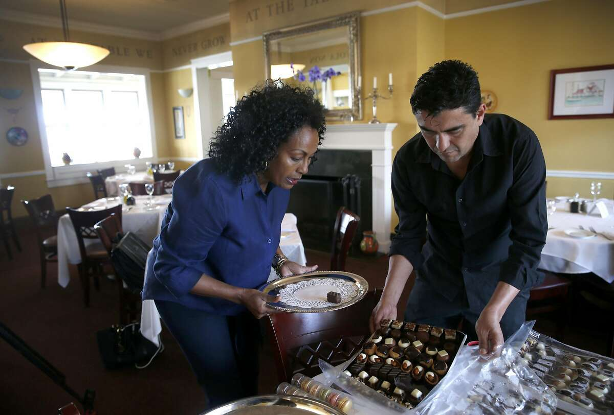 FILE - Restaurateur Menbere Aklilu prepares for an event with waiter Daniel Ayala at Salute e Vita restaurant in Richmond in this 2016 file photo. The popular restaurant and its philanthropic owner Menbere Aklilu were issued a 30-day eviction notice by the property's landowner, which is sparking outrage throughout the community.