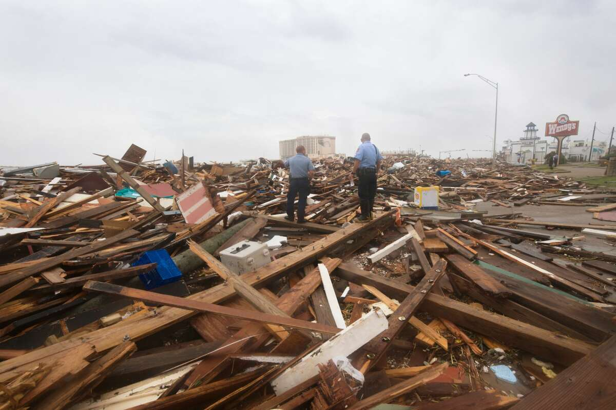 Galveston Police Department officers are dwarfed by the massive destruction caused by Hurricane Ike's monstrous storm surge that struck the southeast Texas coast on September 13, 2008. Nearly every building on the east side of the seawall was obliterated. Hurricane Ike is the costliest hurricane in Texas history. Hurricane Ike is also the second deadliest U.S. hurricane since 1972.