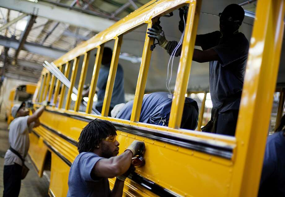 FILE - In this Friday, Sept. 18, 2015, file photo, employees work on a school bus on the assembly line at Blue Bird Corporation's manufacturing facility, in Fort Valley, Ga. On Tuesday, Aug. 9, 2016, the Labor Department releases second-quarter productivity data. (AP Photo/David Goldman, File) Photo: David Goldman, Associated Press