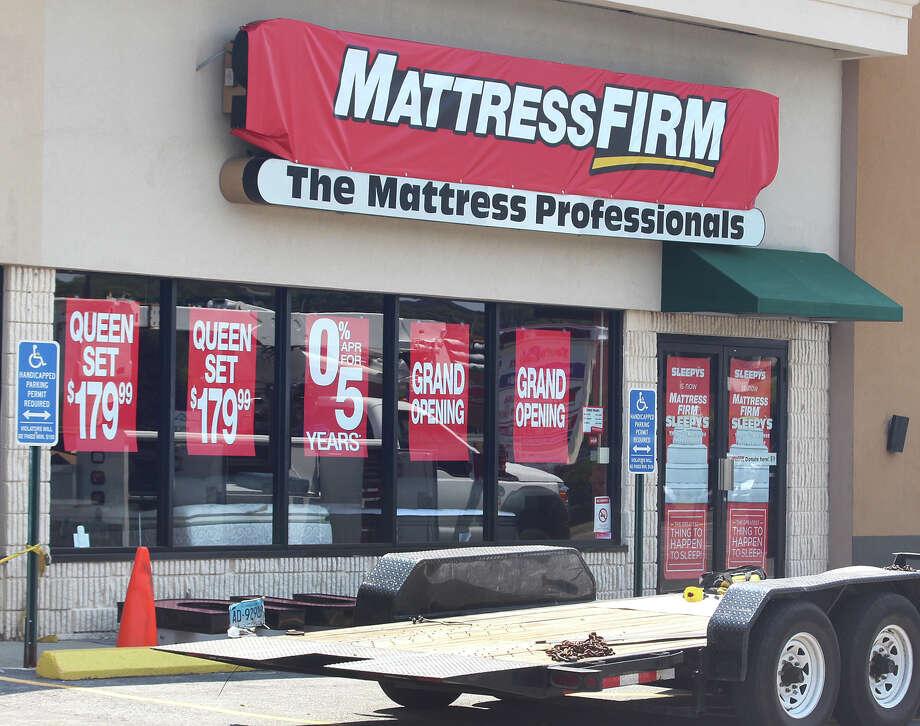 Mattress Firm reports 2nd quarter loss as sales dip San