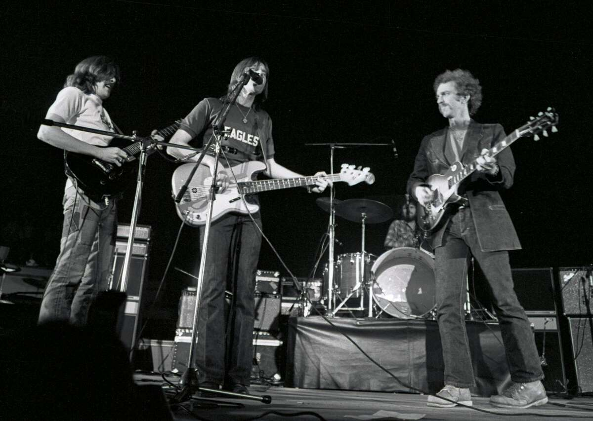 American group Eagles perform live on stage at Concertgebouw in Amsterdam, Netherlands in 1972. Left to right: Glenn Frey, Randy Meisner and Bernie Leadon. (Photo by Gijsbert Hanekroot/Redferns)