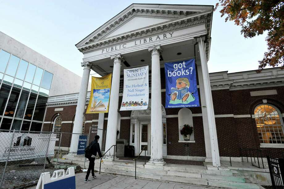 The main branch of Ferguson Library hosted Belle's Book Drive, which collected new and slightly used books to support DOMUS and included story time from several cast members of Beauty & the Beast, which is currently at Stamford's Palace Theater, on Friday, Oct. 30, 2015. Photo: Michael Cummo / Hearst Connecticut Media / Stamford Advocate