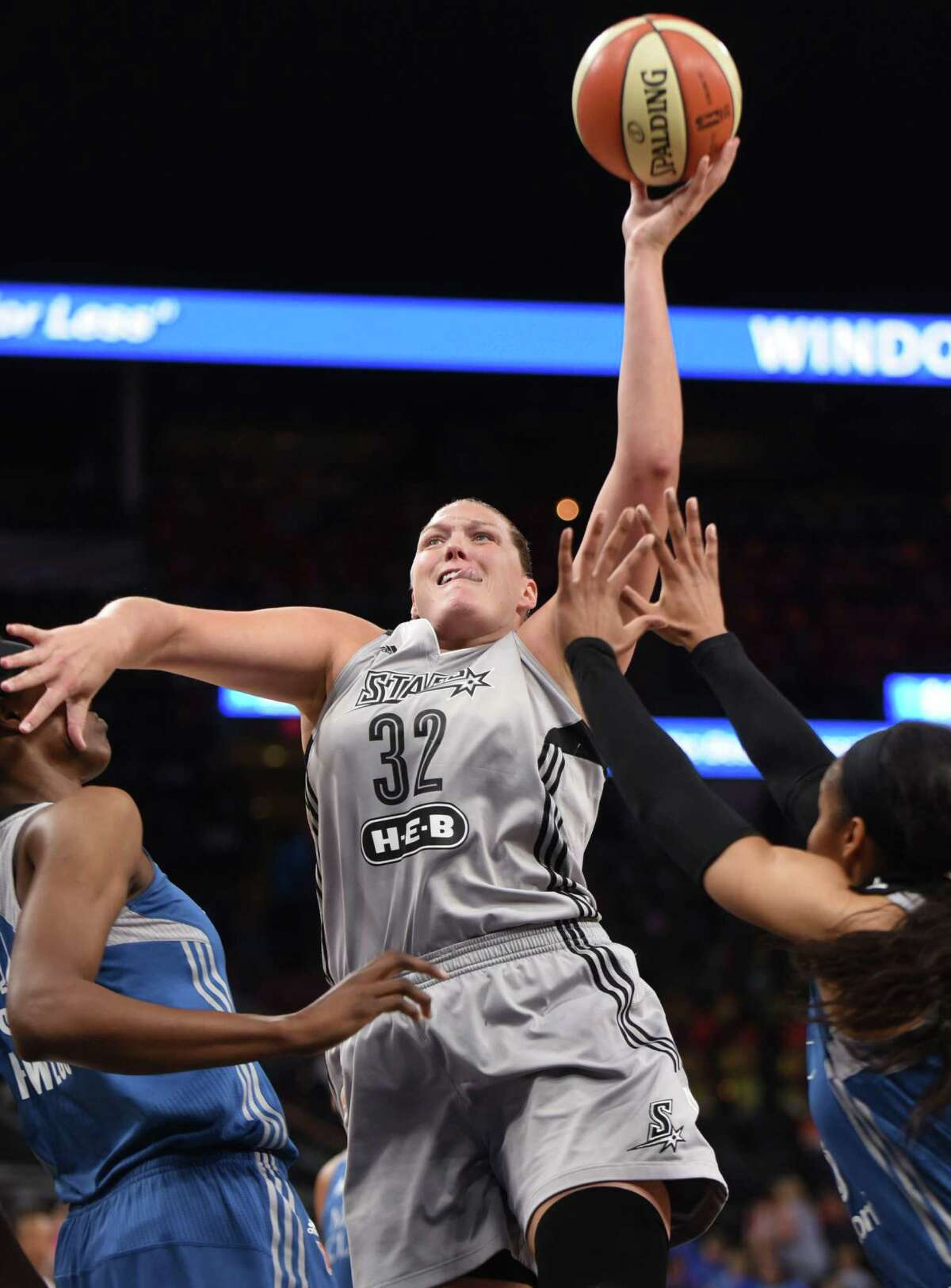 Stars' Jayne Appel-Marinelli (32) pushes aside the Minnesota Lynx's Sylvia Fowles (left) as she shoots at the AT&T Center on July 12, 2016, in San Antonio.