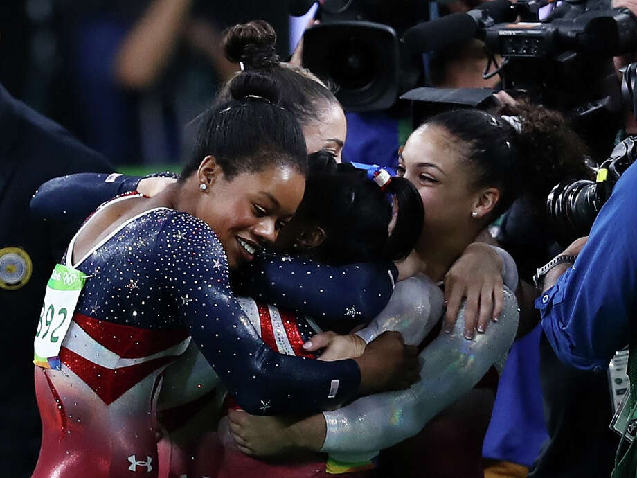 RIO DE JANEIRO, BRAZIL - AUGUST 09:  Simone Biles (C) of the United States is congratulated by her team mates after competing on the floor during the Artistic Gymnastics Women's Team Final on Day 4 of the Rio 2016 Olympic Games at the Rio Olympic Arena on August 9, 2016 in Rio de Janeiro, Brazil.  (Photo by Lars Baron/Getty Images) Photo: Lars Baron/Getty Images