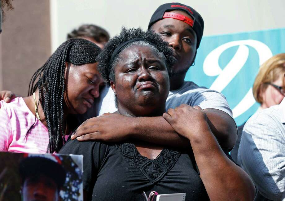 Matrice Stanley, center, sister of Donnell Thompson, who was fatally shot by Los Angeles County Sheriff's deputies in Compton, Calif., Thompson's brother Dwayne Hill, rear, and Antoinette Brown, left, speak to reporters outside the County Hall of Administration after addressing county supervisors in downtown Los Angeles Tuesday, Aug. 9, 2016. The Sheriff's Department earlier Tuesday had acknowledged that Thompson was not involved with a carjacker who had fired at pursuers when he was shot and killed on July 28, 2016. Photo: Nick Ut, AP / Copyright 2016 The Associated Press. All rights reserved. This material may not be published, broadcast, rewritten or redistribu