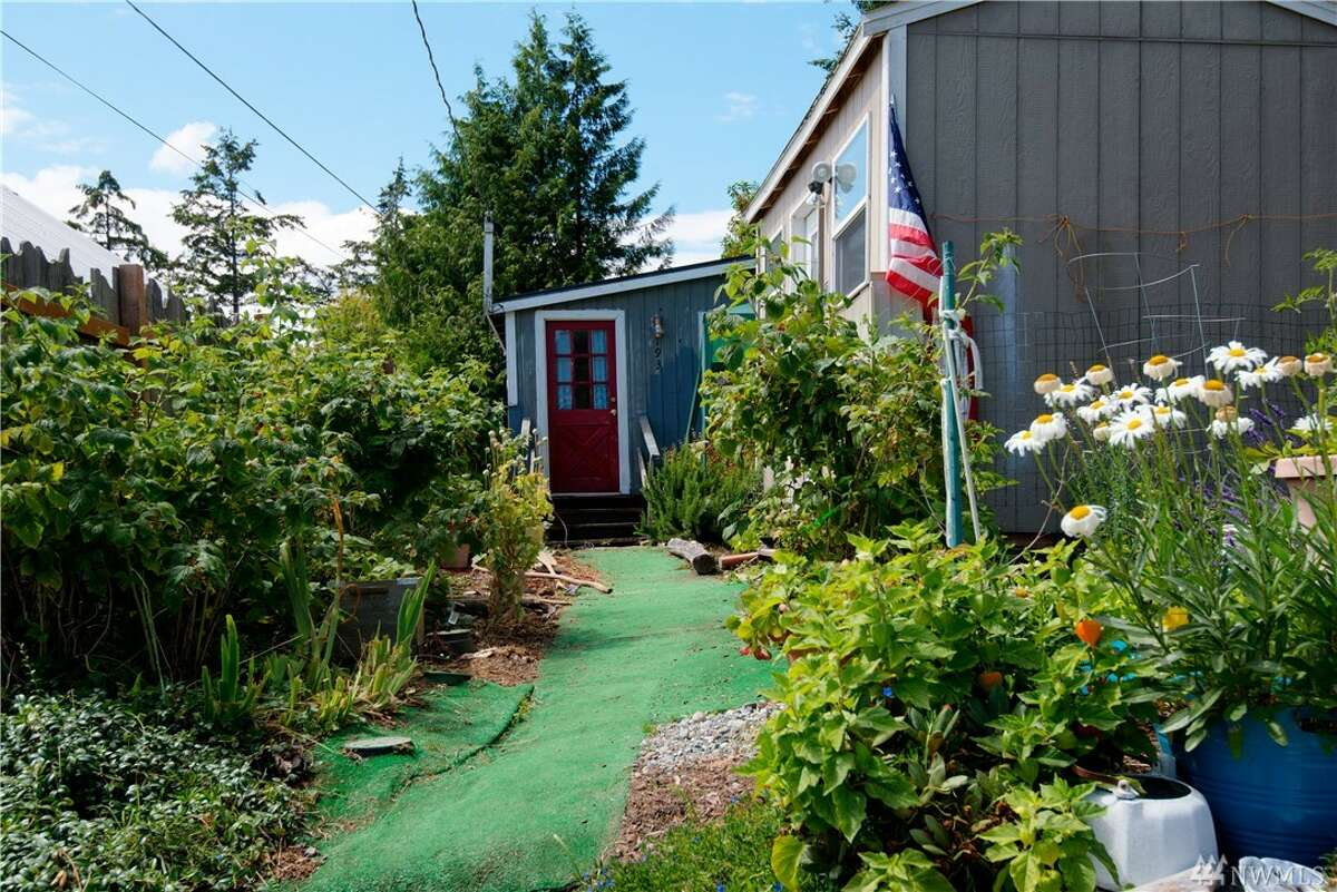 The first home, 193 Maple St., is listed for $139,000. The one bedroom, one bathroom home is 648 square feet. The cute cottage is right on the water in the Madrona Beach community. You can see the full listing here.