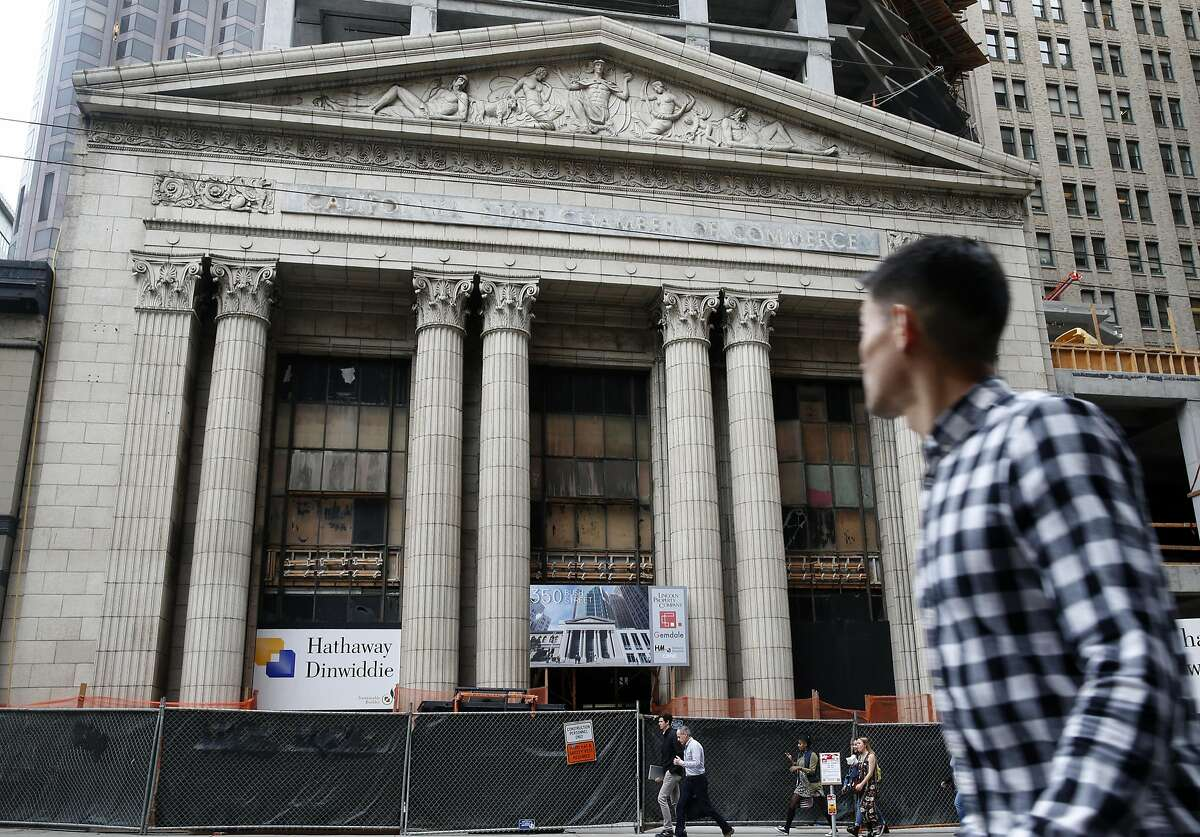 A man walks past the old Mining Exchange Building at 350 Bush Street where construction on a 19-story office tower continues in San Francisco, Calif. on Friday, Aug. 5, 2016.