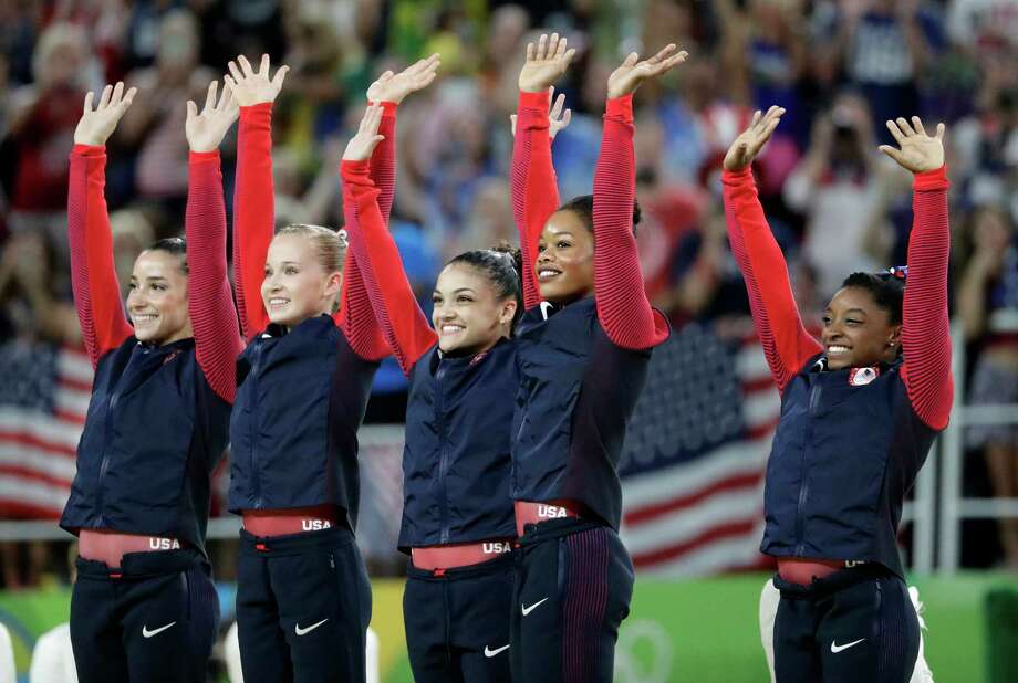U.S. gymnasts and gold medallists, right to left, Simone Biles, Gabrielle Douglas, Lauren Hernandez, Madison Kocian and Aly Raisman acknowledge the crowd during the medal ceremony for the artistic gymnastics women's team at the 2016 Summer Olympics in Rio de Janeiro, Brazil, Tuesday, Aug. 9, 2016. AP Photo/Charlie Riedel) Photo: Charlie Riedel, AP / Copyright 2016 The Associated Press. All rights reserved. This material may not be published, broadcast, rewritten or redistribu