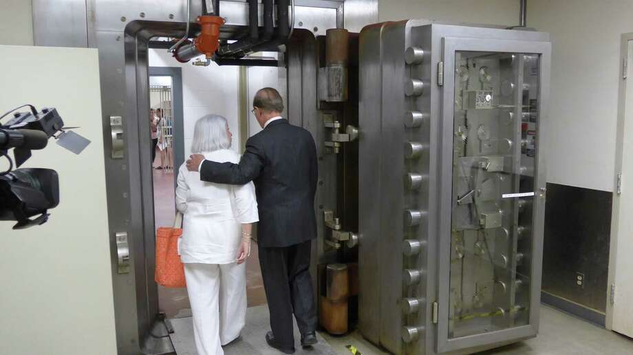 Bexar County Judge Nelson Wolff, right, escorts DRT board of managers member Martha Fleitas into a vault in the county-owned former Federal Reserve Bank building, where Alamo records will be safeguarded under a contract approved Tuesday, Aug. 9, 2016.. Photo: John W. Gonzalez, Express-News Staff