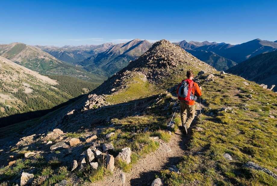 Exploring a high mountain ridge on La Plata Peak in Colorado. Photo: Scott Cramer, Getty Images