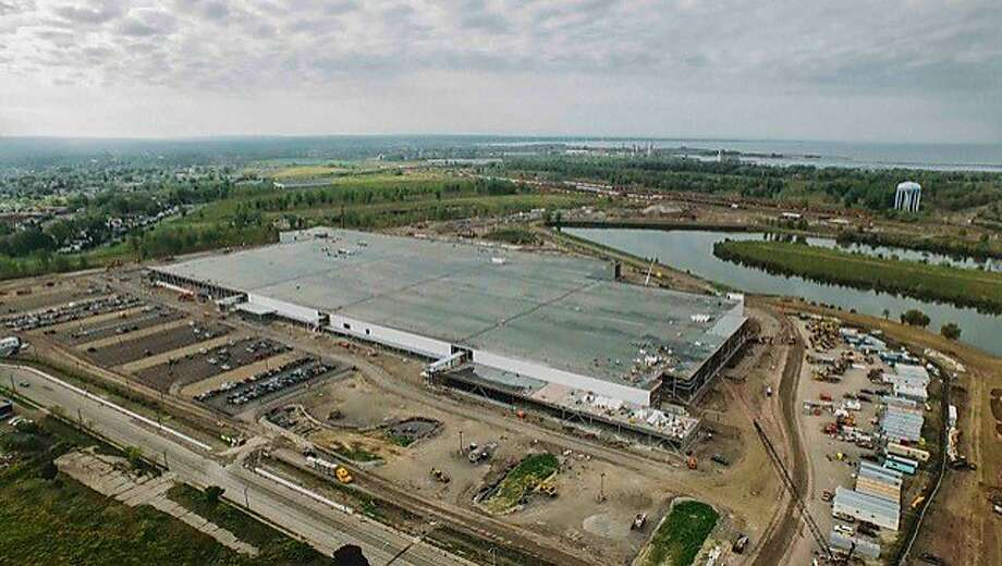 SolarCity's massive panel factory under construction in Buffalo, New York. The San Mateo company will soon offer an integrated solar roof, executives said Tuesday. Photo: SolarCity