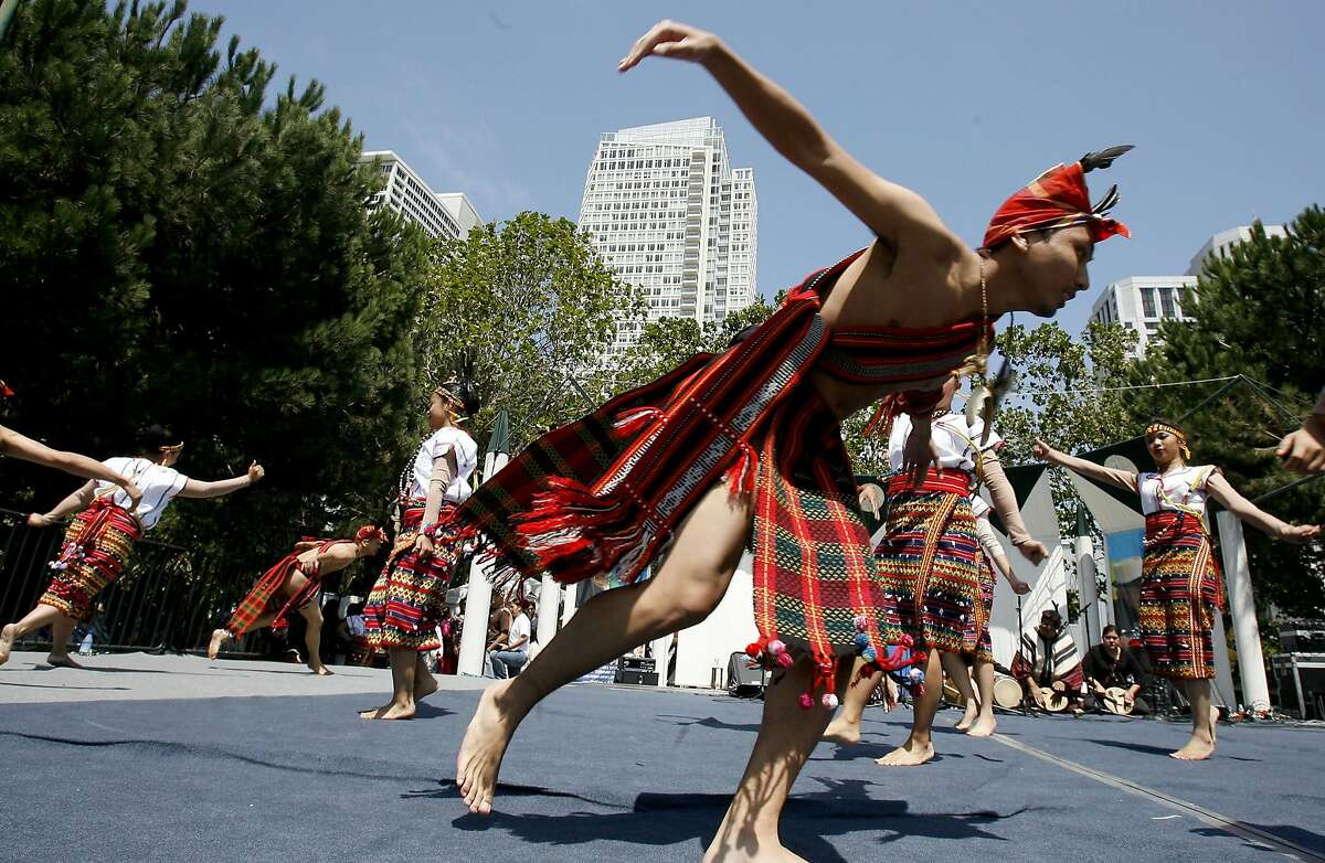 filipino111.jpg Members of the Barangay-San Francisco dance group entertained festival goers early in the afternoon. The 13th annual Pistahan parade and festival were held Sunday to to celebrate the Northern California Filipino community. It was held at the Yerba Buena Gardens in San Francisco. {Brant Ward/The Chronicle} 8/13/06