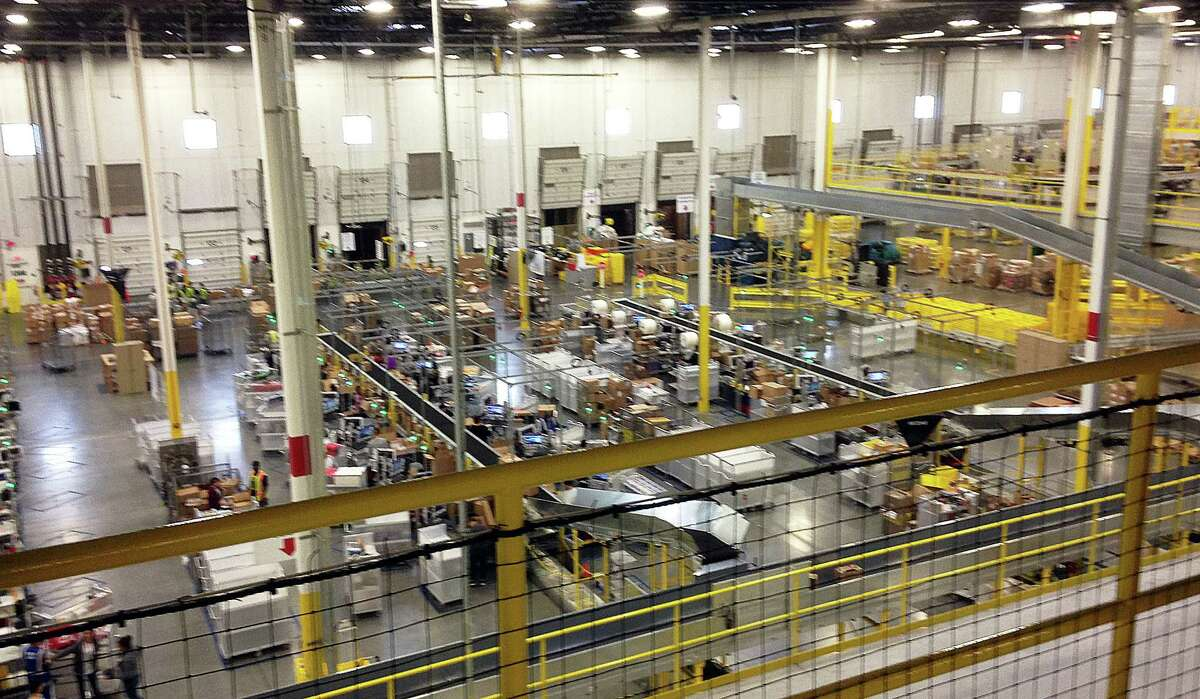 One of Amazon's newest distribution centers in Tracy, Calif., is seen during a tour Sunday, Nov. 30, 2014. This Amazon Fulfillment Center opened in 2013 and was refitted to use new robot technology in the summer of 2014. (AP Photo/Brandon Bailey)
