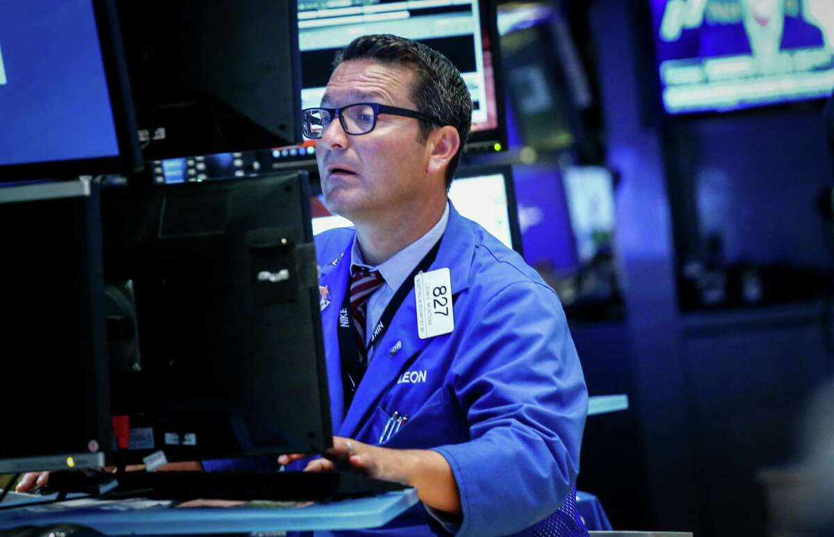NEW YORK, NY - JULY 27: A trader works on the floor of the New York Stock Exchange (NYSE) during the evening of July 27, 2016 in New York City. The dollar fell Wednesday as the U.S. Federal Reserve's latest policy statement caused investors to reassess expectations for interest rate increases in the coming months. (Photo by Kena Betancur/Getty Images) ORG XMIT: 657843467
