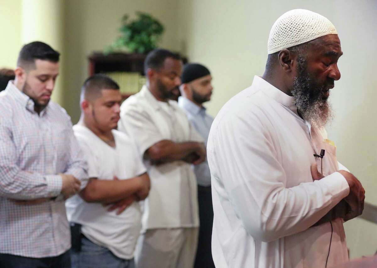 Imam Abdurrahman Vega, right, leads Friday prayers in the mosque at the Islam in Spanish Centro Islamico, Friday, Aug. 5, 2016, in Houston.