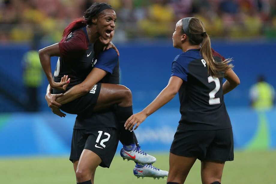 The United States' Crystal Dunn (left) celebrates scoring her team's first goal against Colombia. The match ended in a draw. Photo: Michael Dantas, Associated Press