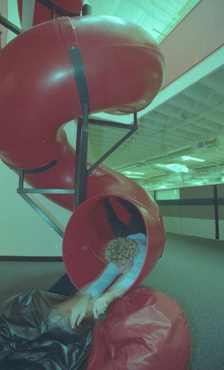 The offices of ExciteAtHome in Redwood City include a slide between floors. Photo: The Chronicle