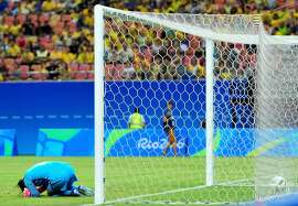 MANAUS, AMAZONAS - AUGUST 09:  Hope Solo #1 of the United States reacts after Angela Clavijo #13 of Colombia scored a goal past her in the first half of the Women's Football First Round Group G match on Day 4 of the Rio 2016 Olympic Games at Amazonia Arena on August 9, 2016 in Rio de Janeiro, Brazil.  (Photo by Bruno Zanardo/Getty Images)