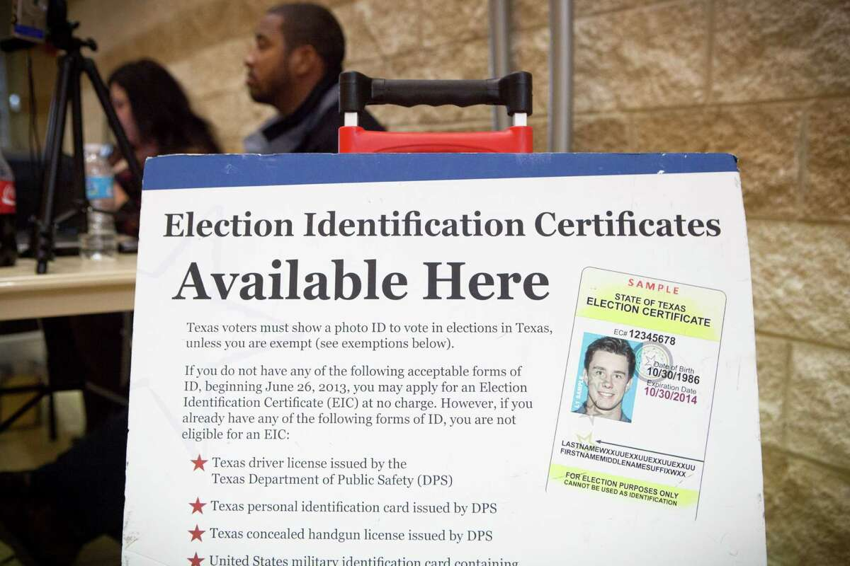 Department of Public Safety employees wait at a Houston voter ID station in Novem ber 2013 after the voter ID law took effect.